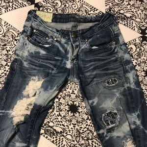 419bf57b75e Acid wash skinny jeans with holes and stud detail